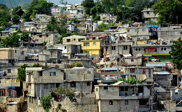 Petionville, one of the towns that makes up the sprawling metropolis of Port-au-Prince, is composed of narrow passages and stairs between concrete buildings that spill down the ubiquitous hills of Haiti before hitting bottom and starting the climb back up.