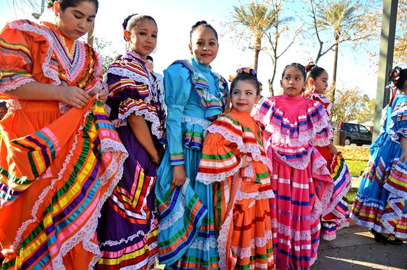Si Se Puede folkloric dancers prepare to perform at a multicultural festival in the Phoenix suburb of Chandler, Ariz.