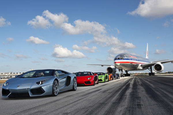 Six Lamborghini Aventador Roadsters line up at Miami International Airport as part of the car's global media debut.