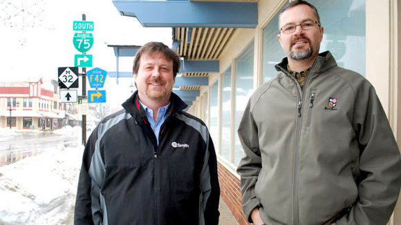 Paul Beachnau (l), executive director of the Gaylord Area Convention and Tourism Bureau and Gaylord Area Chamber of Commerce, and chamber board president Justin Kowatch stand in front of 319 W. Main St., which will house both agencies.