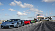 Do not adjust your monitors; those are indeed six Lamborghini Aventador Roadsters cutting in front of a Boeing 777 on a runway at Miami International Airport. Don't worry, it was sanctioned.