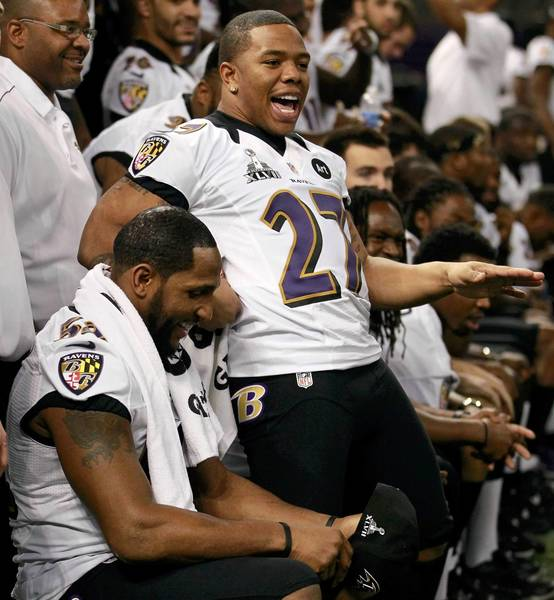 Baltimore Ravens running back Ray Rice (27) sits down next to linebacker Ray Lewis (L) as they gather for their team picture during Media Day.