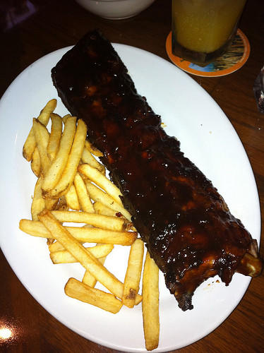 Ribs are very fatty, and the barbeque sauce often has sugar as an ingredient.  On top of that the ribs at Outback Steakhouse are about 1,156 calories.  Instead of buying ribs, make them yourself, and trim all visible fat before and after cooking.  You can also cook the ribs with seasoning instead of coating it with an excessive amount of sauce.