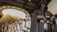 Darth Vader and a squadron of more than a dozen Imperial soldiers and Stormtroopers stroll into Chicago's Adler Planetarium on a Thursday night and gather around a large-scale model of the Earth as if planning to attack it with their superweapon the Death Star.