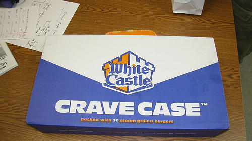 "Each White Castle slider with cheese is 170 calories.  15 sliders are 2,550 calories, which is just half of a ""Crave Case"" that holds a total of 30 sliders."