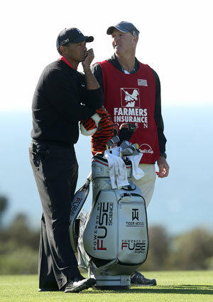 Tiger Woods waits with caddie Joe LaCava on the 17th hole  during the final round of the Farmers Insurance Open at Torrey Pines.