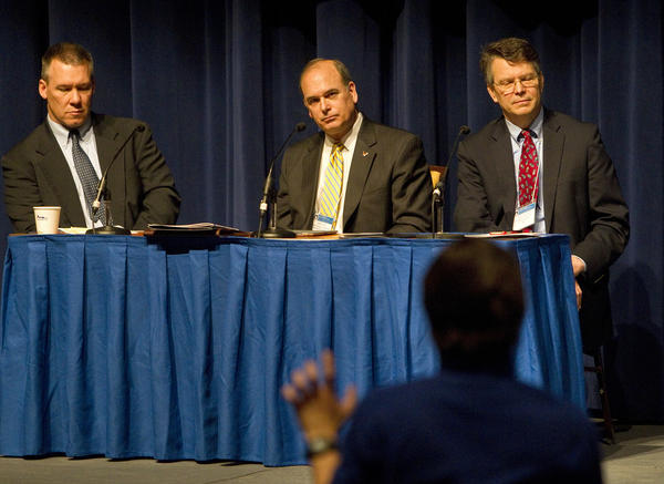 From left) Daniel M. Bell, Jr., Steven Bucci and Randy Casey-Rutland listen to a question during a forum on the ethics of surveillance at the fourth annual Workshop on Intelligence and National Security at Christopher Newport University on Tuesday.