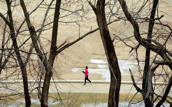 A jogger runs in Forest Beach Park in Lake Forest.