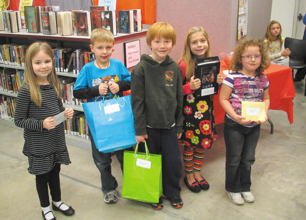 From left, Madeline Stevens, Clear Spring Elementary, fourth place, a $50 Target Gift Card; (tie) Wesley Blood, Sharpsburg Elementary, third place, book package and Ashlyn Connoley, Ruth Ann Monroe Primary School, third place, book package; Corrin Line, Rockland Woods Elementary, first place, Kindle Fire; and Karissa Mitchell, Winter Street Elementary, second place, $100 Walmart gift card. Not pictured: Claire Houseknecht, third-grade teacher at Rockland Woods Elementary, who received a check for $100 for her classroom.