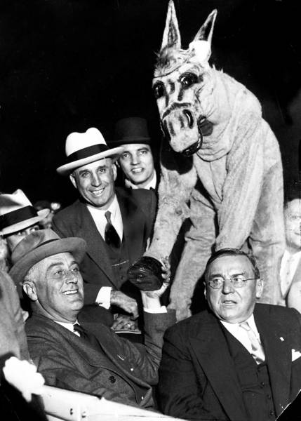After winning the Democratic nomination on July 1, 1932, Franklin D. Roosevelt broke precedent and flew to Chicago to address the Democratic convention. Here he accepts congratulations from the Democratic donkey. Seated next to Roosevelt is Chicago Mayor Anton Cermak.