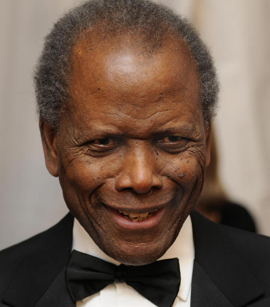 "Award-winning actor <a class=""taxInlineTagLink"" id=""PECLB003433"" title=""Sidney Poitier"" href=""/topic/entertainment/sidney-poitier-PECLB003433.topic"">Sidney Poitier</a> is still stellar at 83. (Photo by MIKE THEILER/AFP/Getty Images)"