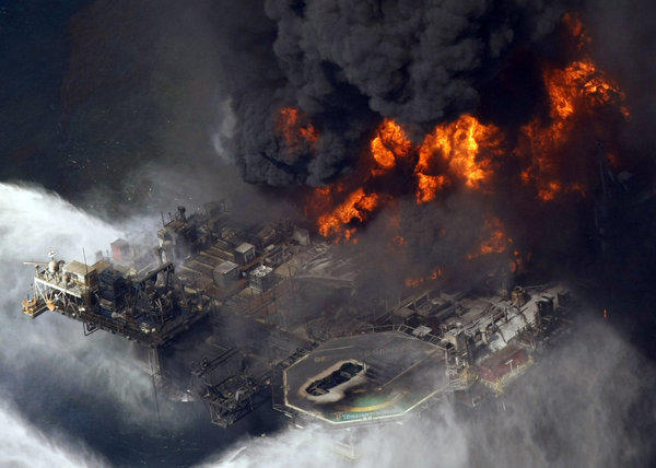 The Deepwater Horizon oil rig burns in the Gulf of Mexico after an explosion in 2010. A U.S. judge approved an agreement for British oil giant BP to plead guilty to manslaughter charges in the death of 11 workers.