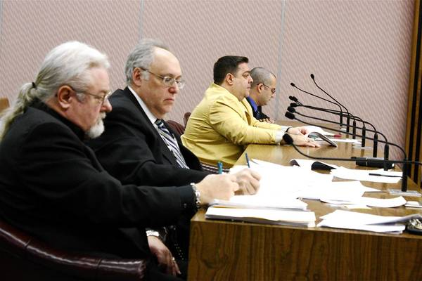 From left, Des Plaines resident Brian Burkross, attorney Jeffrey Greenspan, 5th Ward aldermanic candidate Gregory Sarlo and attorney Adam Salzman appear before the city's electoral board to hear Burkross' challenge to Sarlo's candidate petition signatures.