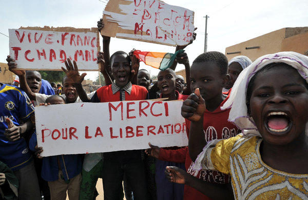 Joyous villagers in Ansongo, south of Gao, celebrate their liberation by French and Malian troops after 10 months of occupation by Islamic militants. France hopes to hand over the mission to an African-led contingent soon, but analysts say the West will have to provide logistical and intelligence support for years if the militants are to be denied a foothold in North Africa.