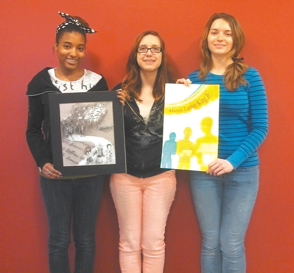Winners in the MLK Day of Service and Celebration art contest are, from left, Nahja Collins, second place; Lauren Giannola, tied for third place with Liana James (not pictured); and Erin Mettille, first-place winner.