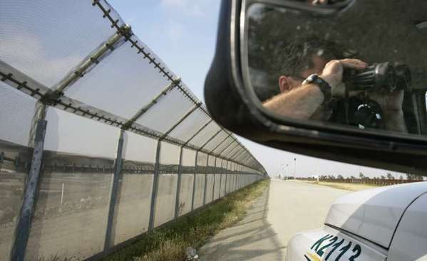 A Border Patrol agent keeps watch at the U.S.-Mexico border near Otay Mesa, Calif. In Neveda on Tuesday, President Obama unveiled a proposal that would provide a path to citizenship for undocumented immigrants while boosting enforcement.