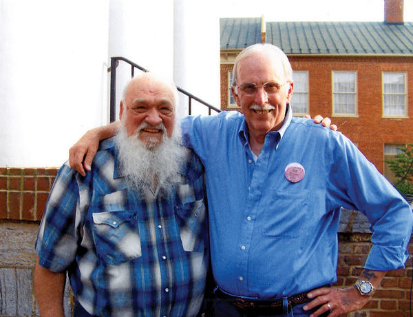 From left, Jack Wink of Berkeley Springs, W.Va., and Bill Emerson of Vienna, Va., are shown on the courthouse steps in Winchester, Va., where the Sweet Dixie Bluegrass Band performed last summer.