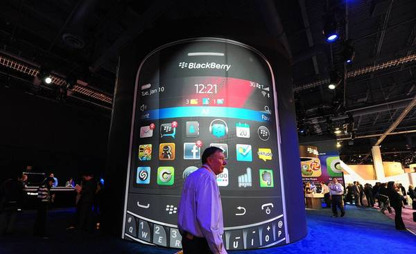 A man walks past a BlackBerry display at the 2012 International Consumer Electronics Show in Las Vegas. BlackBerry maker Research in Motion has lost significant share in the U.S. and other crucial markets in the last few years as consumers flocked to other smartphones.