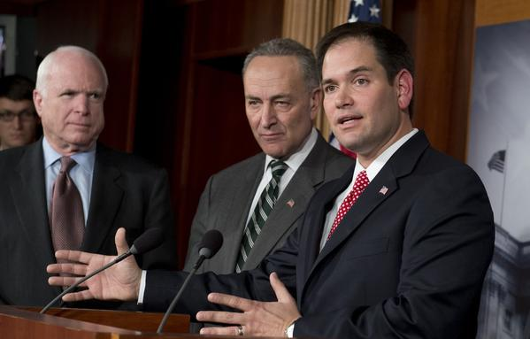 U.S. Sen. Marco Rubio takes the podium to discuss a bipartisan immigration reform bill, accompanied by, from left, Sen.  John McCain, Sen. Chuck Schumer, Sen. Robert Menendez and Sen. Dick Durbin during a press conference at the Capitol on Jan. 28.