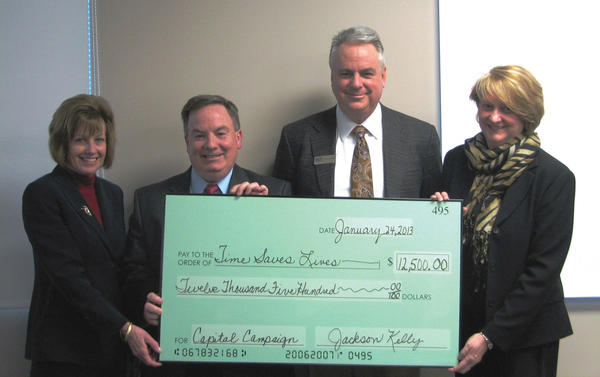 Donating and accepting a $12,500 donation from the law firm of Jackson Kelly PLLC in support of the Time Saves Lives capital campaign are, from left, Teresa McCabe, West Virginia University Hospitals-East¿s Time Saves Lives program; William Powell, Jackson Kelly; Robert Baronner, Time Saves Lives program; and Lynn Frye, Jackson Kelly.