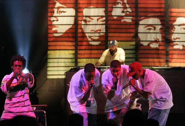The reunited L.A.-based hip-hop crew Jurassic 5 includes Akil, left, Soup, Chali 2na, Marc 7 and DJ NuMark, in the background.