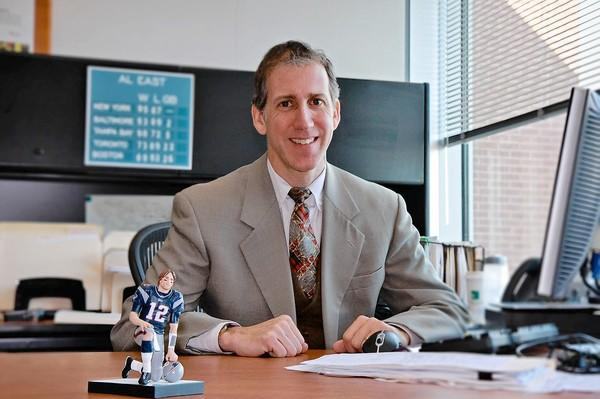 David Nitkin, director of communications for Howard County Government, keeps his Tom Brady figurine on his desk during football season.
