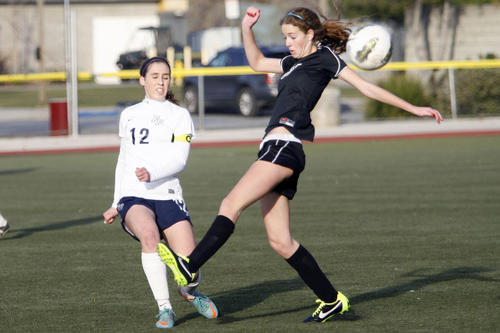 Flintridge Prep's Whitney Cohen, left, and Westridge's Julia Matthiessen fight for the ball during a game at the Glendale Sports Complex on Tuesday, January 29, 2013.