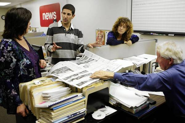 Alan Smolinisky, center, talks with Palisadian-Post publisher Roberta Donohue, left, staff writer Laurie Rosenthal and managing editor Bill Bruns while visiting the Pacific Palisades office.