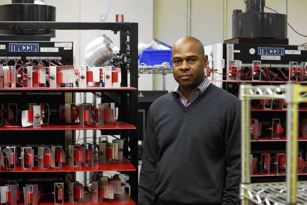 Les Alexander, of Navitas, at the Ann Arbor, Mich., laboratory of A123, which Navitas bought.