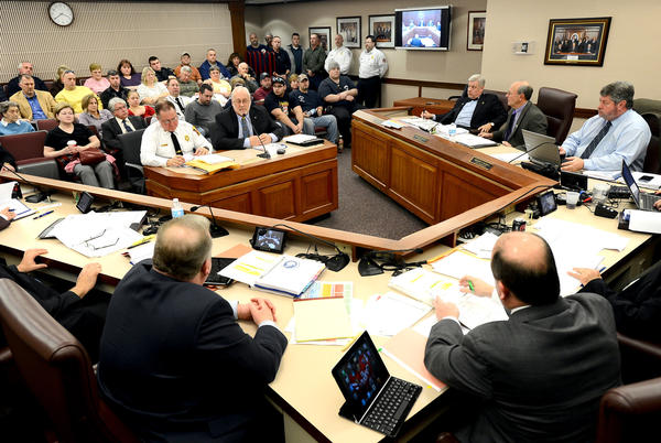 Fairplay Fire Company Task Force member Charlie Summers, left, Deputy Director Department of Emergency Services of Washington County, and Task Force Chairman Paul Miller, right, speak Tuesday afternoon during the task force's report to the Washington County Board of Commissioners.