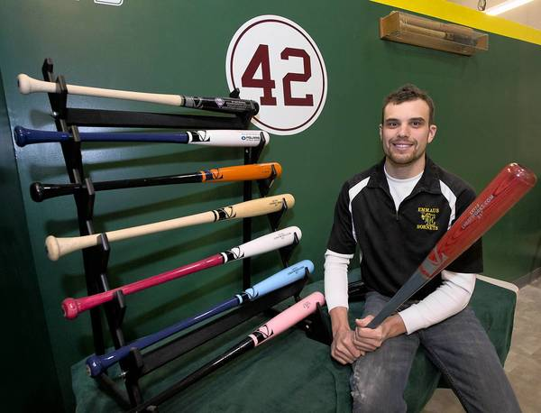 Co-owner Steve Toth stands next to a display of his baseball bat product at Lehigh Valley Bat Works in East Allen Township on Tuesday.