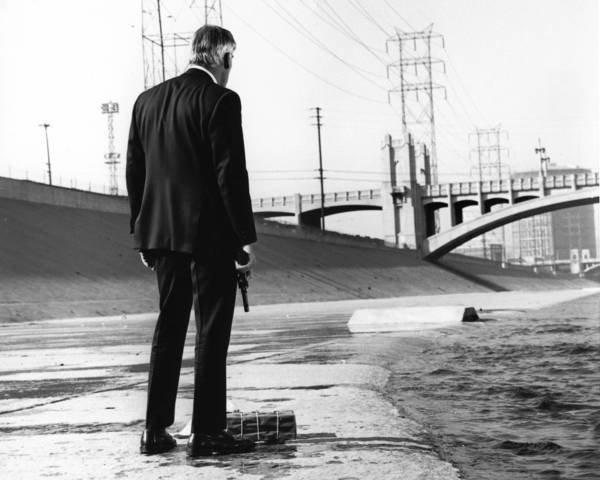 "Lee Marvin at the 4th Street Bridge in a scene from ""Point Blank."""