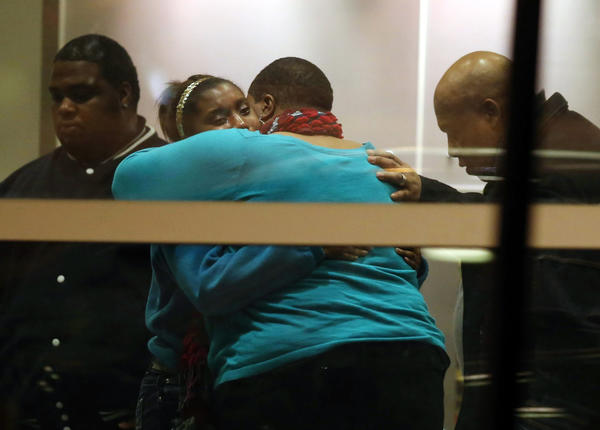 Family of 15-year-old shooting victim Hadiya Pendleton grieve at Comer Children's Hospital after the fatal shooting in the 4500 block of South Oakenwald.