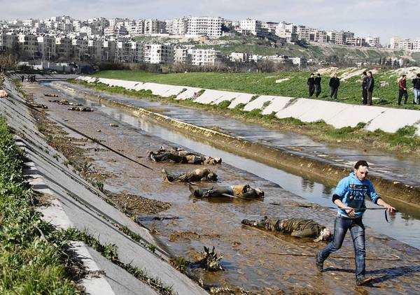 Bodies of young men, many handcuffed and with bullet holes in their heads, were found in a muddy riverbed in Aleppo, the latest atrocity in Syria for which no one has claimed responsibility.