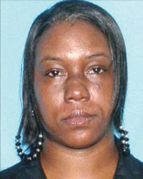 Adrienne P. Simmons was shot dead outside a Lauderhill condominium and police were searching for the shooter