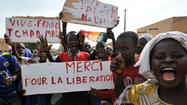 French troops backing a Mali government campaign to retake the northern half of the country from Islamic militants have been cheered as liberators since their convoys rolled into historic Timbuktu this week and hundreds of paratroopers dropped from the sky to block the occupiers' escape.