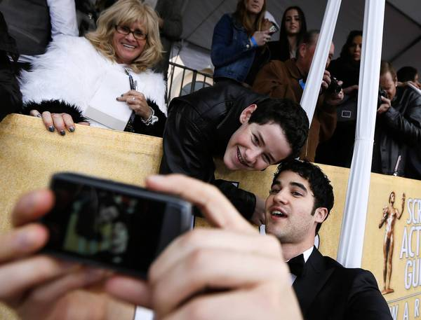 "Actor Darren Criss of ""Glee,"" bottom right, poses for a photo with fan Coby Hillborne, 16, of Woodland Hills, at the 19th Screen Actors Guild Awards."