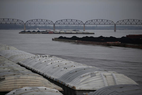 Barge traffic on the Ohio River near the confluence with the Mississippi River at Cairo, Illinois, December 19, 2012.