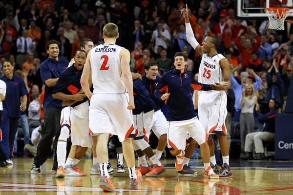 Geoff Burke/USA TODAY Sports Photo Virginia players celebrate after their win against N.C. State on Tuesday in Charlottesville.