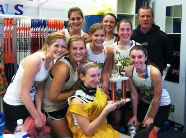 The Howard Stampede team members celebrate their championship at the MLK Champions of Tomorrow Tournament. Pictured in the back row, from left, are: Maureen Maclean (Centennial High School), Lexi Souder (Marriotts Ridge) and coach Doug Hamilton. Middle row: Mollie Belson (Atholton), Caitlin Carr (Mount de Sales), Katie Anderson (Mt. Hebron), Keally Ingersoll (Marriotts Ridge) and Enya McGarry (Marriotts Ridge). Front: Sarah Chernikoff (Patapsco Middle School).