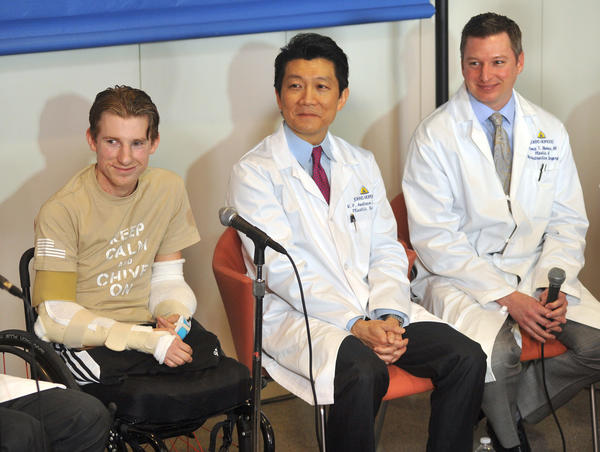 From left, Brendan Marrocco, Dr. W.P. Andrew Lee, and Dr. Jamie Shores.  Brendan Marrocco, attended a press conference held at Johns Hopkins Hospital with his team of doctors to discuss his bilateral arm transplant surgery, which was done on Dec. 18, 2012. Marrocco lost all four limbs in a roadside bomb attack in Iraq in 2009. Marrocco, from Staten Island, NY is the first successful double arm transplant at JHH, and only the 7th patient in the U.S. to undergo this surgery.