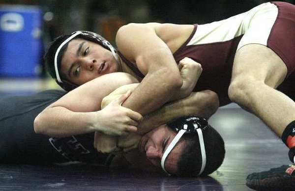Anthony Landeros (132-pounder), in red, was one of six Spartans to notch pinfall victories against Hoover Tuesday.