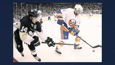 New York Islanders center Frans Nielsen (51) clears the puck in front of Pittsburgh Penguins left wing Chris Kunitz (14) during the second period of an NHL hockey game in Pittsburgh on Tuesday.