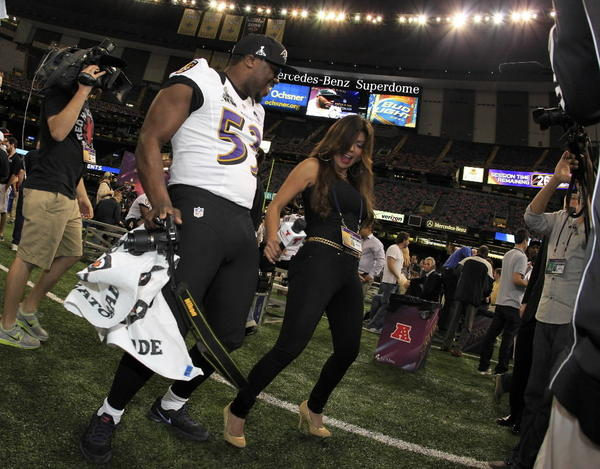 The Baltimore Ravens' Jameel McClain dances with Telemundo reporter Mirrella Grisales.