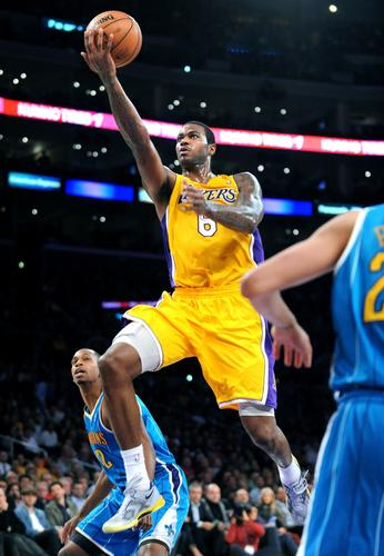 Lakers forward Earl Clark scores on a layup against the Hornets.