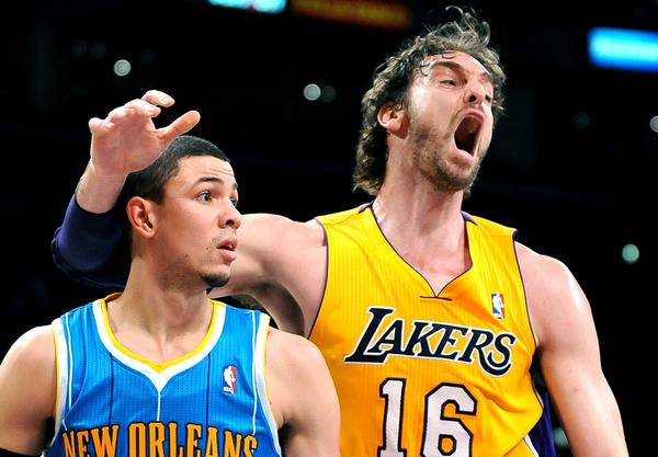 Lakers big man Pau Gasol wants a foul called as he bumps into Hornets guard Austin Rivers.