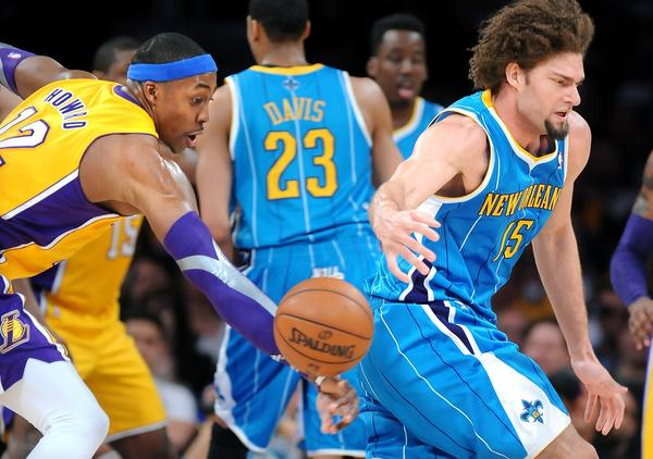 Lakers center Dwight Howard strips the ball from Hornets center Robin Lopez.