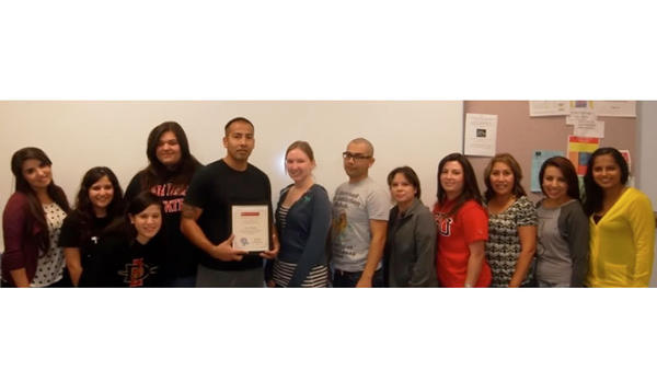 The San Diego State University-Imperial Valley campus Psychology Club poses with the first recipient of its $200 book scholarship, Rudy Mercado.