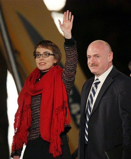 Former U.S. Rep. Gabrielle Giffords, left, and her husband, retired astronaut Mark Kelly, are pictured in January 2012, a year after she was wounded in a shooting that killed six others. Kelly will be among those testifying Wednesday at the year's first Senate hearing on what lawmakers should do to curb gun violence.