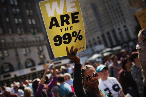 An Occupy Wall Street supporter holds up a sign during a 2011 protest on Fifth Avenue in New York City.